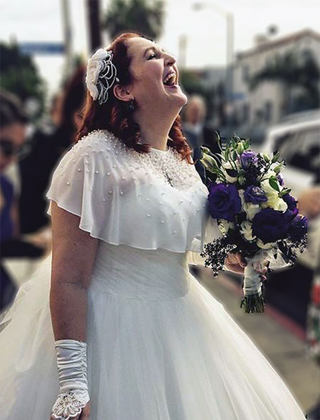Carma Spence on her wedding day, laughing