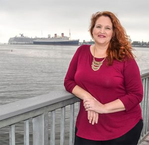 Carma Spence with Long Beach's Queen Mary in the background