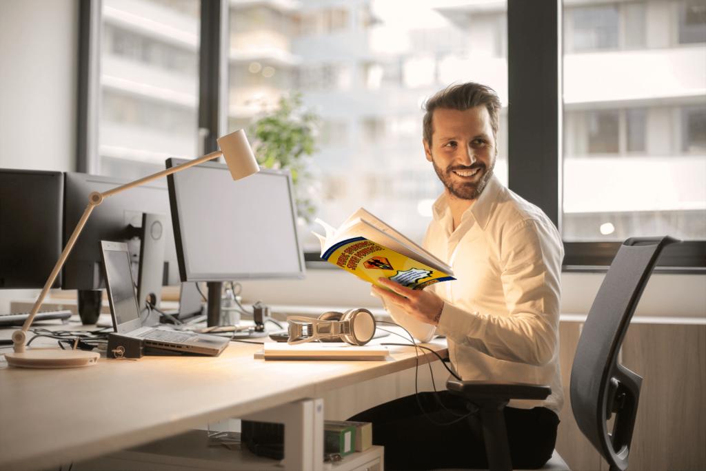 Man in an office reading Public Speaking Super Powers